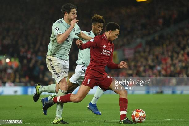 Liverpool's English defender Trent AlexanderArnold is chased by Bayern Munich's Spanish defender Javi Martinez and Bayern Munich's French striker...