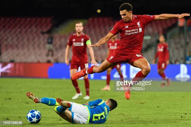 Liverpool's English defender Trent AlexanderArnold jumps over Napoli's Portuguese defender Mario Rui during the UEFA Champions League group C...