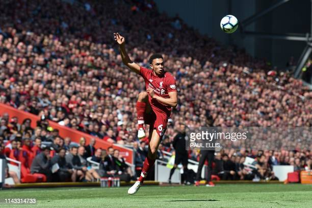 TOPSHOT Liverpool's English defender Trent AlexanderArnold plays the ball during the English Premier League football match between Liverpool and...