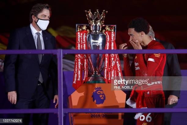 Liverpool's English defender Trent Alexander-Arnold recieves his Premier League winner medals during the presentation following the English Premier...