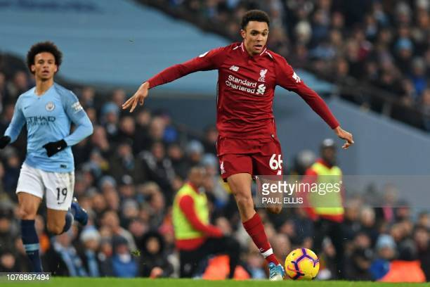 Liverpool's English defender Trent AlexanderArnold runs with the ball during the English Premier League football match between Manchester City and...