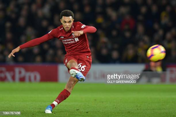 Liverpool's English defender Trent AlexanderArnold scores from this freekick during the English Premier League football match between Watford and...