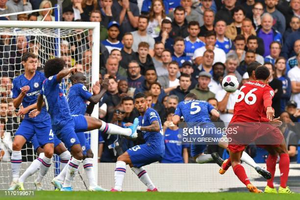 Liverpool's English defender Trent AlexanderArnold shoots to score the opening goal during the English Premier League football match between Chelsea...