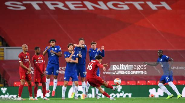 Liverpool's English defender Trent AlexanderArnold takes a free kick to scores his team's second goal during the English Premier League football...