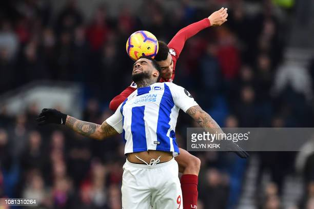 Liverpool's English defender Trent AlexanderArnold vies with Brighton's Dutch striker Jurgen Locadia during the English Premier League football match...