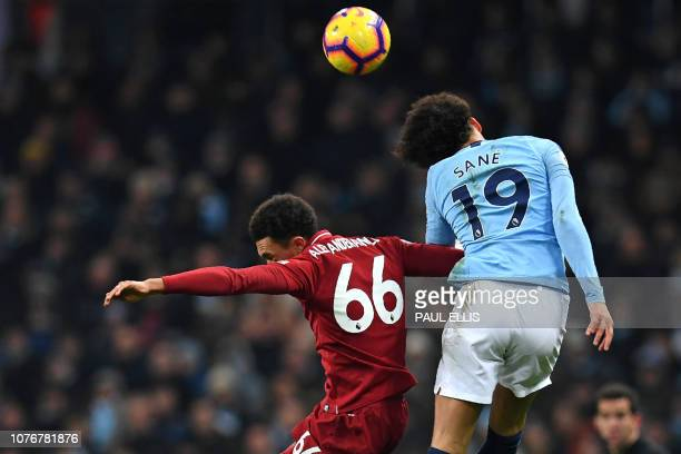 Liverpool's English defender Trent AlexanderArnold vies with Manchester City's German midfielder Leroy Sane during the English Premier League...