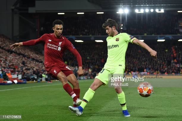 Liverpool's English defender Trent Alexander-Arnold vies with Barcelona's Spanish midfielder Sergi Roberto during the UEFA Champions league...