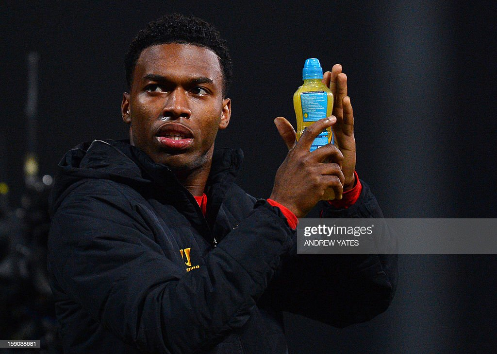 "Liverpool's English forward Daniel Sturridge applauds fans after the 2-1 win against Mansfield Town during the FA Cup third round football match in Mansfield, central England, on January 6, 2013. USE. No use with unauthorized audio, video, data, fixture lists, club/league logos or ""live"" services. Online in-match use limited to 45 images, no video emulation. No use in betting, games or single club/league/player publications."