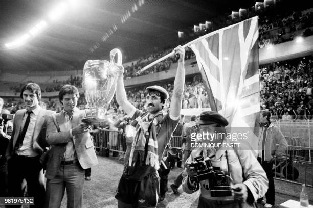 Liverpool's English forward David Johnson holds the trophy as he celebrates winning the European Cup final football match between Liverpool and Real...