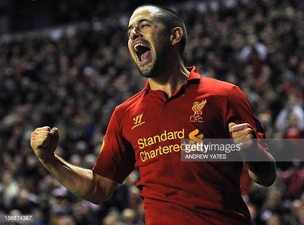 Liverpool's English forward Joe Cole celebrates after scoring his team's second goal during the UEFA Europa League group A football match between...