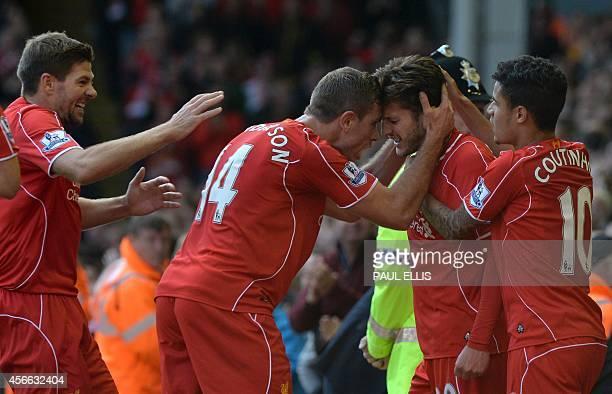 Liverpool's English midfielder Adam Lallana celebrates with teammates with Liverpool's Brazilian midfielder Philippe Coutinho Liverpool's English...