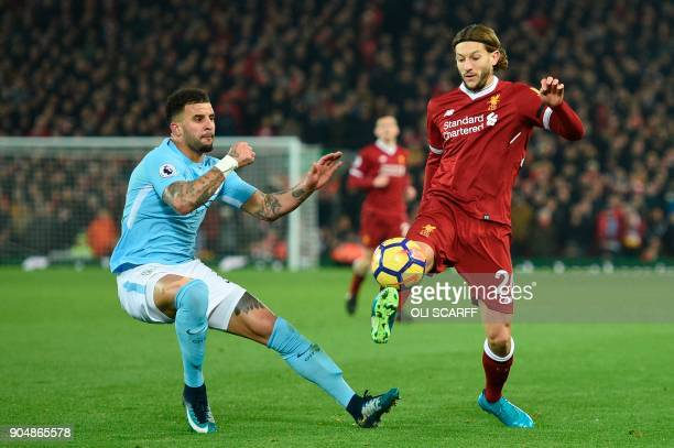 Liverpool's English midfielder Adam Lallana controls the ball under pressure from Manchester City's English defender Kyle Walker during the English...