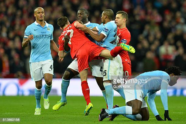 Liverpool's English midfielder Adam Lallana gets involved in a confrontation with Manchester City's Brazilian midfielder Fernandinho and Manchester...