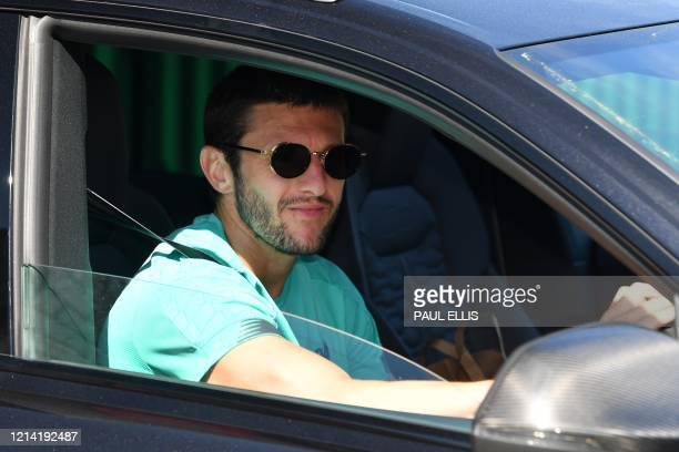Liverpool's English midfielder Adam Lallana leaves from Melwood in Liverpool north west England to resume training on May 20 as training resumes...