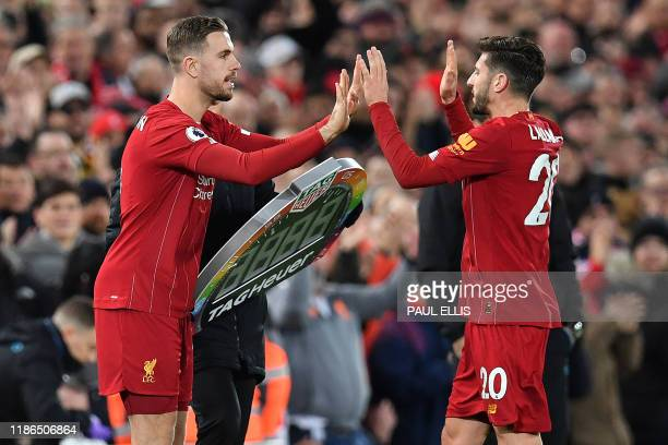 Liverpool's English midfielder Adam Lallana leaves the pitch after being substituted off Liverpool's English midfielder Jordan Henderson during the...