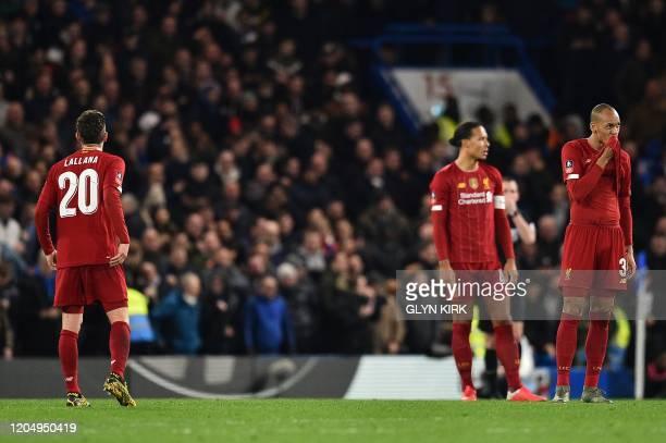 Liverpool's English midfielder Adam Lallana Liverpool's Dutch defender Virgil van Dijk and Liverpool's Brazilian midfielder Fabinho react during the...