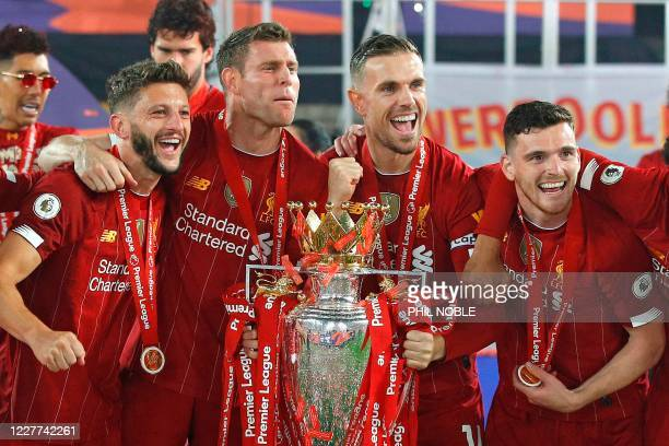 Liverpool's English midfielder Adam Lallana, Liverpool's English midfielder James Milner, Liverpool's English midfielder Jordan Henderson and...