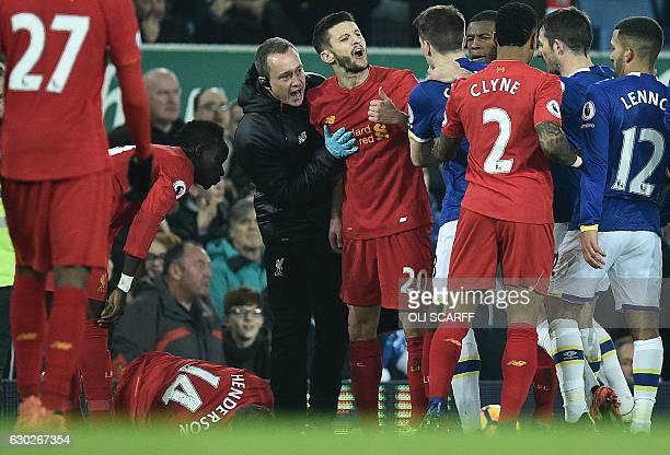 Liverpool's English midfielder Adam Lallana remonstrates with Everton's Irish defender Seamus Coleman following Everton's English midfielder Ross...