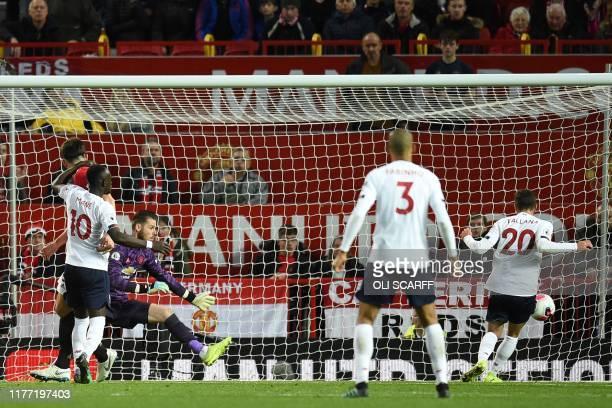 TOPSHOT Liverpool's English midfielder Adam Lallana scores their first goal during the English Premier League football match between Manchester...