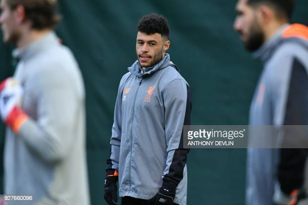 Liverpool's English midfielder Alex OxladeChamberlain and teammates participate in a training session prior to the UEFA Champions League round of...