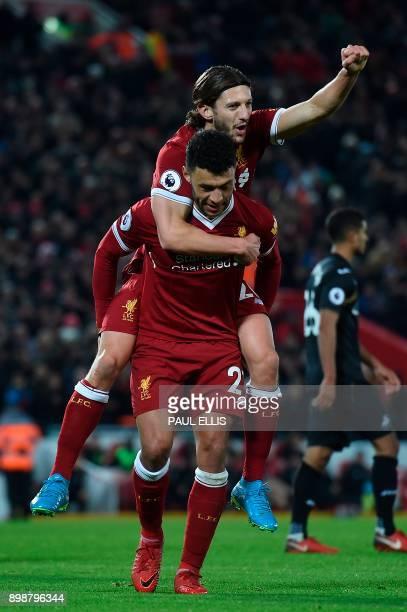 Liverpool's English midfielder Alex OxladeChamberlain celebrates scoring their fifth goal with Liverpool's English midfielder Adam Lallana during the...