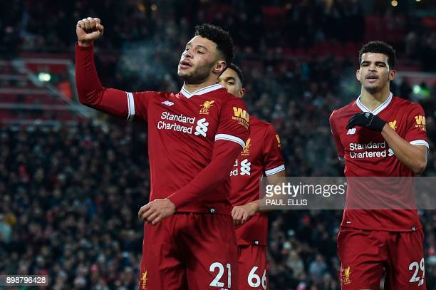 Liverpool's English midfielder Alex OxladeChamberlain celebrates scoring their fifth goal with Liverpool's English midfielder Trent AlexanderArnold...