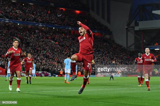 Liverpool's English midfielder Alex OxladeChamberlain celebrates scoring the team's second goal during the UEFA Champions League first leg...