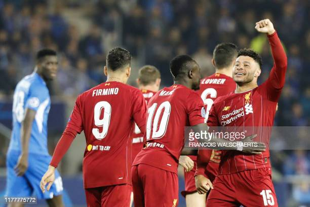 Liverpool's English midfielder Alex OxladeChamberlain celebrates with teammates after scoring a goal during the UEFA Champions League Group E...