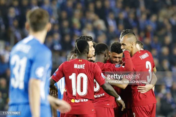 Liverpool's English midfielder Alex Oxlade-Chamberlain celebrates with teammates after scoring a goal during the UEFA Champions League Group E...