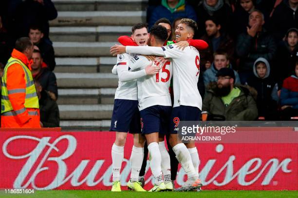 Liverpool's English midfielder Alex OxladeChamberlain celebrates with teammates after scoring the opening goal during the English Premier League...