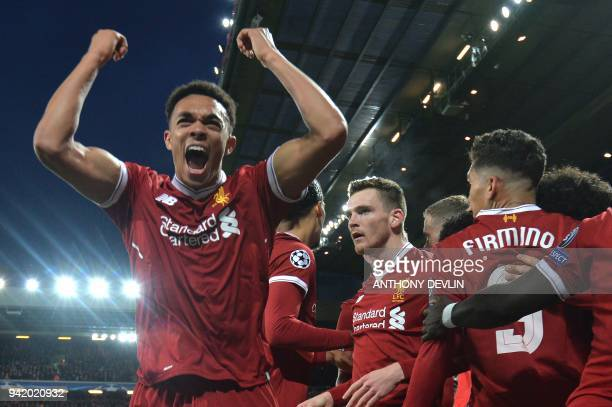Liverpool's English midfielder Alex OxladeChamberlain celebrates with teammates scoring the team's second goal during the UEFA Champions League first...