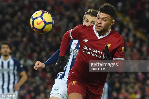 Liverpool's English midfielder Alex OxladeChamberlain chases the ball during the English Premier League football match between Liverpool and West...