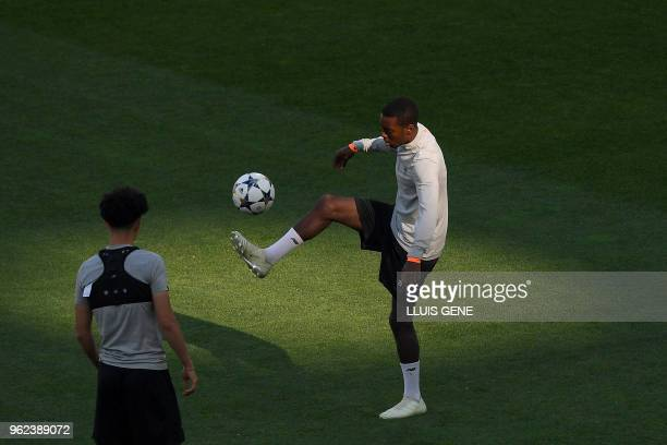 Liverpool's English midfielder Alex OxladeChamberlain controls the ball during a Liverpool team training session at the Olympic Stadium in Kiev...