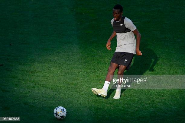 Liverpool's English midfielder Alex OxladeChamberlain kicks the ball during a Liverpool team training session at the Olympic Stadium in Kiev Ukraine...