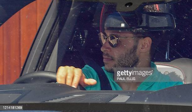 Liverpool's English midfielder Alex OxladeChamberlain leaves Melwood in Liverpool north west England after training on May 20 as training resumes...