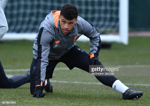 Liverpool's English midfielder Alex OxladeChamberlain participates in a training session prior to the UEFA Champions League round of sixteen second...