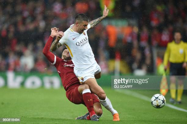 Liverpool's English midfielder Alex OxladeChamberlain picks up an injury tackling Roma's Croatian defender Aleksandar Kolarov during the UEFA...