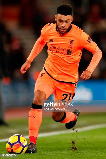Liverpool's English midfielder Alex OxladeChamberlain runs with the ball during the English Premier League football match between Southampton and...