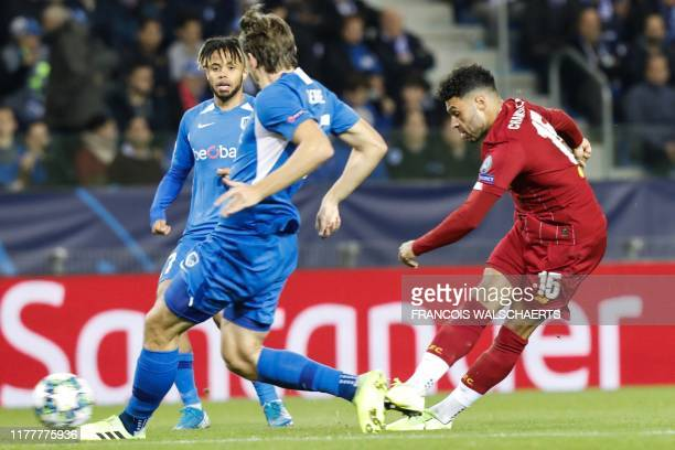 Liverpool's English midfielder Alex OxladeChamberlain shoots and scores a goal during the UEFA Champions League Group E football match between Genk...