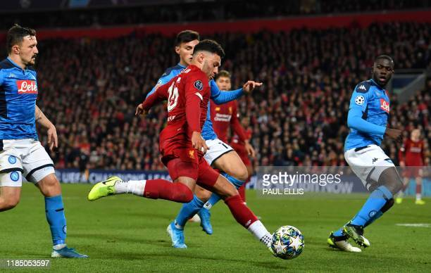 Liverpool's English midfielder Alex OxladeChamberlain shoots but fails to score during the UEFA Champions league Group E football match between...