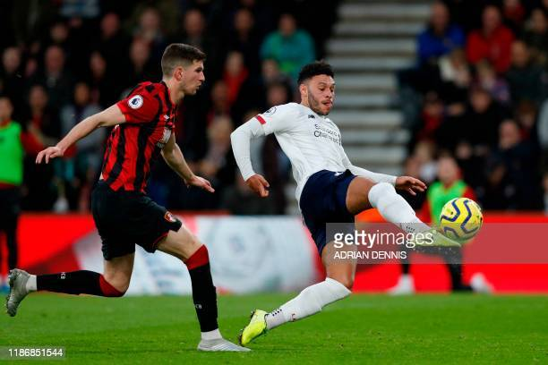 Liverpool's English midfielder Alex OxladeChamberlain strikes the ball to score the opening goal ahead of Bournemouth's Welsh defender Chris Mepham...