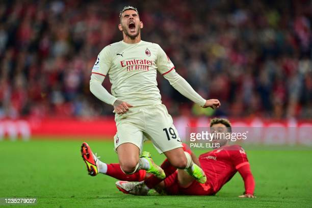 Liverpool's English midfielder Alex Oxlade-Chamberlain tackles AC Milan's France's defender Theo Hernandez during the UEFA Champions League 1st round...