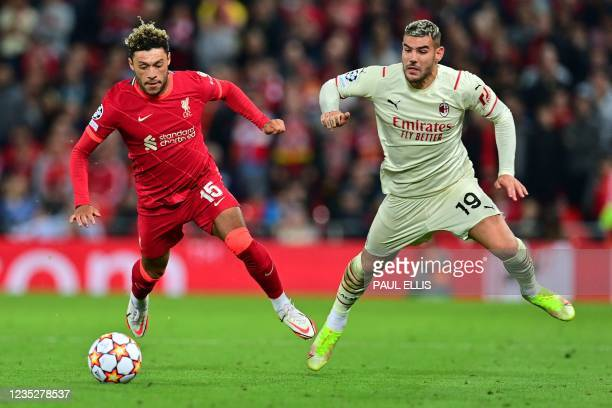 Liverpool's English midfielder Alex Oxlade-Chamberlain vies with AC Milan's France's defender Theo Hernandez during the UEFA Champions League 1st...