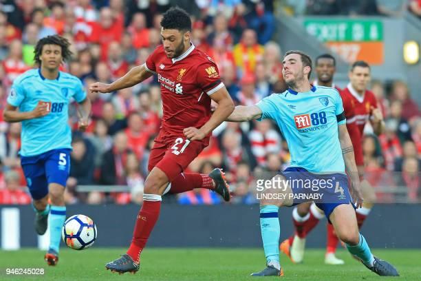 Liverpool's English midfielder Alex OxladeChamberlain vies with Bournemouth's English midfielder Dan Gosling during the English Premier League...