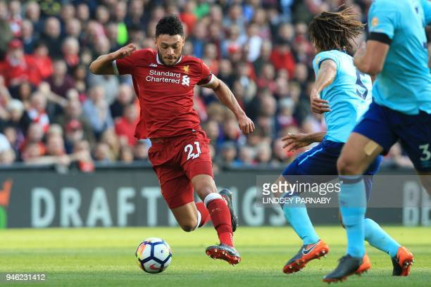 Liverpool's English midfielder Alex OxladeChamberlain vies with Bournemouth's Dutch defender Nathan Ake during the English Premier League football...