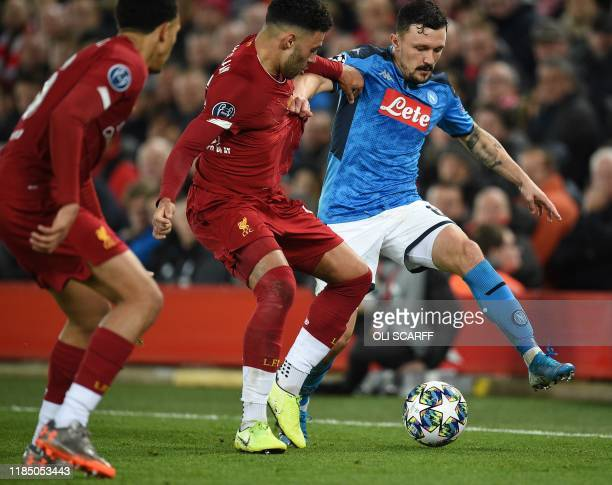 Liverpool's English midfielder Alex OxladeChamberlain vies with Napoli's Portuguese defender Mario Rui during the UEFA Champions league Group E...