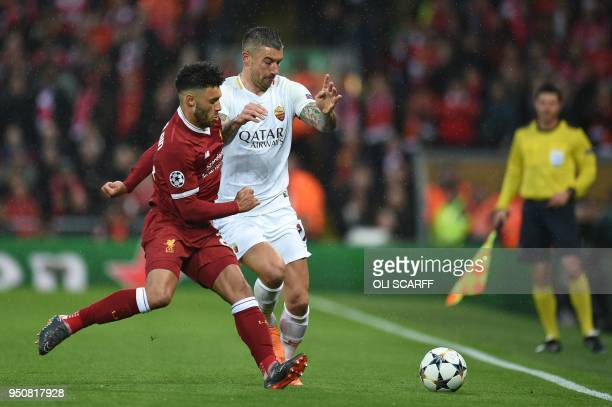 Liverpool's English midfielder Alex OxladeChamberlain vies with Roma's Croatian defender Aleksandar Kolarov during the UEFA Champions League first...