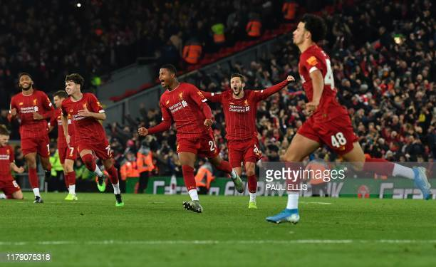 Liverpool's English midfielder Curtis Jones celebrates after scoring the winning penalty in a penalty shootout during the English League Cup fourth...
