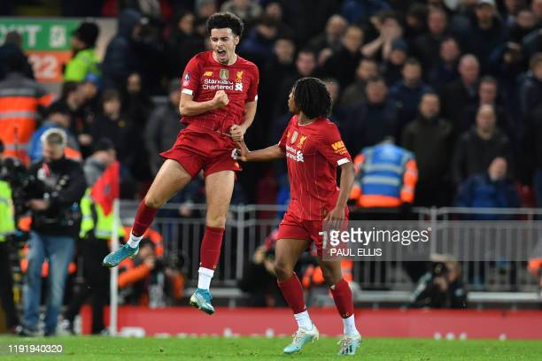 Liverpool's English midfielder Curtis Jones celebrates after scoring the opening goal of the English FA Cup third round football match between...