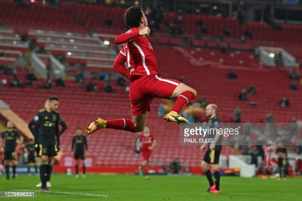 Liverpool's English midfielder Curtis Jones celebrates after scoring the opening goal during the UEFA Champions League 1st round Group D football...